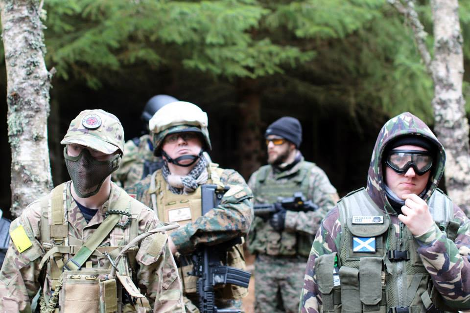 Group of men playing airsoft